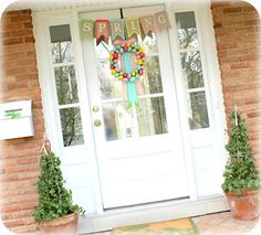 Pretty spring banner and wreath. ....front door decor