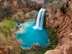 Havasu Falls in Supai, AZ, is one of the most famous and most visited waterfalls in the Grand Canyon. The site consist of 1 main chute that drops over a 120-foot vertical cliff. Hikers can relax, stop for lunch and sit at the picnic tables near the waterfall.