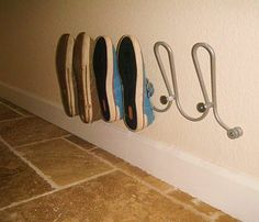 I have these Ikea towel racks. Great idea for shoes.