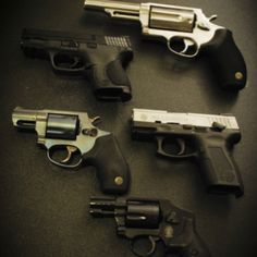 smaller silver revolver:bulldog, right side:taurus usp, above small silver revolver: s&w m&p 40 and maybe at the top a taurus judge public defender