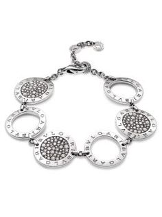 Bvlgari 18k White Gold Pave Diamond and White Gold Circle Bracelet. 18k White Gold Adjustable Bracelet with 3 Large Pave Diamond Circles and 3 White Gold Circles. Available at London Jewelers.