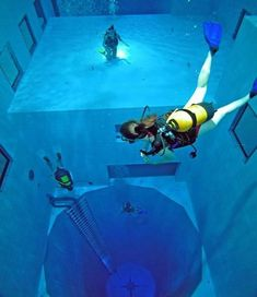Nemo 33, a recreational scuba diving center in Uccle, Belgium is home to the deepest diving pool in the world. The pool has two large flat-bottomed areas at depth levels of 16 ft and 32 ft, and a large circular pit descending to a depth of 108 ft