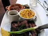 Dinner Market - Carne Asada Strips & Charro Beans Flavorful herbs & spices and the sparkle of lime juice turn these carne asada strips into something special! Pintos, chiles, bacon & spices simmer together to create authentic Mexican cowboy beans to serve with. GLUTEN FRIENDLY