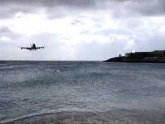 this is how planes land on the island of st. maarten. incredible!