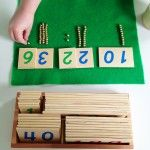 Building  numerals with Golden Beads and color-coded Numeral Cards