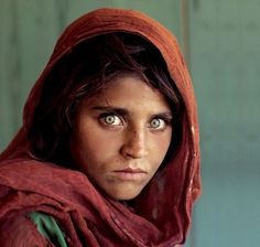 The Afghan Girl is one of the most popular and recreated images in the world, shot by National Geographic photographer Steve McCurry. The Afghan Girl is Sharbat Gula, a student at an informal school within a refugee camp. It was the time of the Soviet occupation of Afghanistan. She has also been often referred to as the Afghan Mona Lisa.