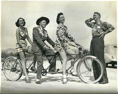 Jinx Falkenburg, Jack Benny and Peggy Diggins ride a bike. Charles Farrell wears a shirt.
