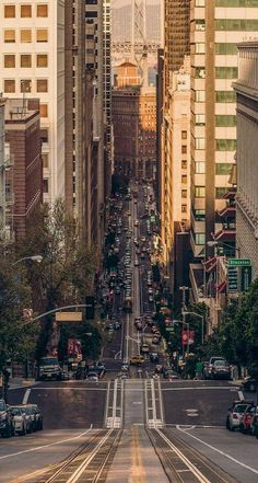 CALIFORNIA STREET, looking toward the financial district, with the Bay Bridge in the background. San Francisco, California.