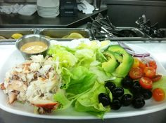 Crab Louie at The Franciscan Crab Restaurant - arrange baby iceberg lettuce on a large serving plate and garnish with sliced avocado, pitted black olives, halved cherry tomatoes and a sliced hard boiled egg. top with crab meat. serve with louie dressing  made of mayonnaise, cocktail sauce, lemon juice and pickle relish 415.362.7733