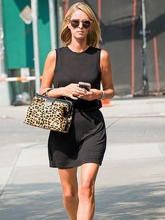 Newlywed Nicky Hilton accessorized a casual black dress with an animal print tote 'n' matching patterned sunnies for wild flair!