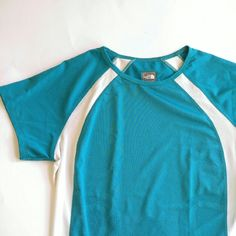 North Face Athletic Shirt vapor wick blue white Sm Vapor Wick shirt by the North Face Authentic! -Short sleeves-Fitted shape-Aqua blue green color with flattering white insets at sides- Comfortable lightweight material, very nice feeling.-Size: womens Small- In like new condition, slightly wrinkled from storage- From a smoke free home:)  POSHC8688NORTH888 The North Face Tops Tees - Short Sleeve