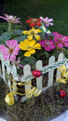 Mom's Little Garden Centerpiece - Nursery flowers in a picket fence made by the kids, Flowers can be planted in mom's garden!