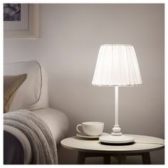 IKEA - ÖSTERLO, Table lamp with LED bulb, Fabric shade gives a diffused and decorative light. Easy to clean; the shade fabric is removable and machine washable. Ikea Canada, Ikea Us, Clear Light Bulbs, Ikea Living Room, Kitchens And Bedrooms, Led Lampe, Fabric Shades, Home Staging, Light Decorations