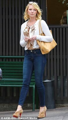 Katherine Heigl looks amazing as she showed off her curves in skin tight jeans and sky scraper heels. #legs #heels