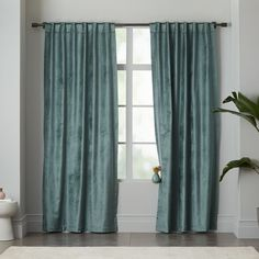 """Luster Velvet Curtain - Blue Stone,  Glossy + glam. Made of thick velvet with a high-sheen finish, our Luster Velvet Curtain is instant window dressing in the bedroom, living room and beyond.  60% cotton, 40% rayon in Blue Stone.  Available as a single panel (48""""w) or double wide panel (96""""w).    48W x 84L"""