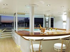 TV is a stunning luxury motor yacht built in 2008 by Lurssen Yachts. Luxury Yacht Interior, Luxury Yachts, Luxury Homes, Lurssen Yachts, Indoor Jacuzzi, Indoor Pools, Sailboat Interior, Bbq Set, Luxury Dining Room