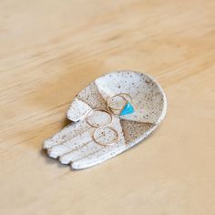 These ceramic hands by artist Ivy Weinglass are perfect to hold your rings, incense, and small odds and ends.