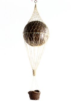 Sail away with an antique toy hot air balloon.