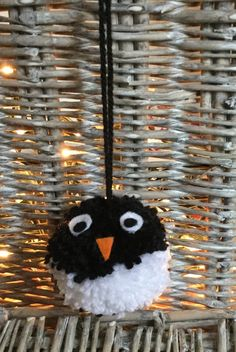 Christmas penguin hanging pom pom decoration - a pompomette for your home! From Little Pea Handmade on Etsy