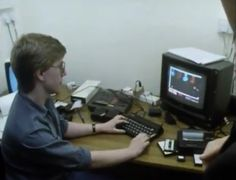 """Jonathan """"Joffa"""" Smith demos Pud Pud at Ocean software (image from BBC documentary 'Commercial Breaks')"""