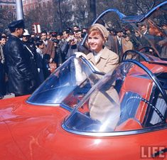 "Debbie Reynolds and Glenn Ford in the Lincoln Futura from the 1959 MGM film ""It Started with a Kiss"""