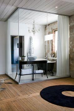 Baños con paredes de cristal