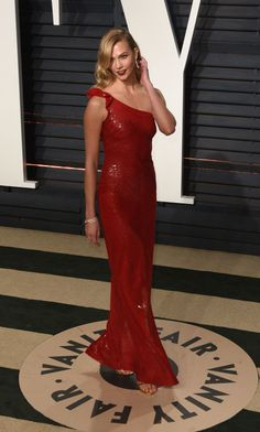 Karlie Kloss makes red on red look so good at the Vanity Fair Oscar Party.