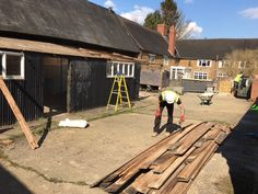 Safety first! One of our Assistant Site Managers flattening nails on boards we have removed to make them safe.