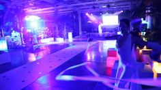 Colored lights, dancers with white ribbons, an aerial hoop artist, video projections and surround music for a glamorous welcome