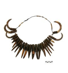 Philippines | Boar's teeth and tusk necklace on fiber from the Bontoc Igoraot people of Luzon.