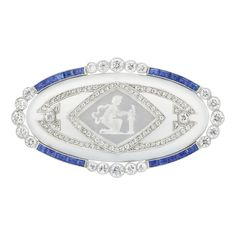 Platinum, Frosted Rock Crystal, Diamond, Sapphire and Reverse Crystal Intaglio Brooch,  circa 1920.