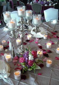 Candelabras make for a great table centerpiece! The pintuck linen is also one of our personal favorites! #wedding #reception