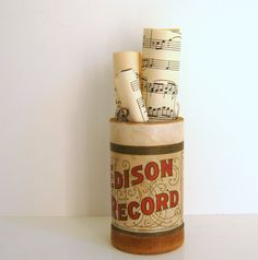fill containers w/ rolled sheet music - via Etsy.