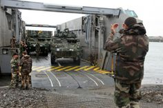 Part of equipment and 200 troops of Canadian 5th Mechanised Brigade Group disembarking from high speed landing craft from French Marine Nationale BPC Mistral. BPCs similar to LPDs. Part of Exercise lion Mistral 20-21 June 2014, near Quebec.