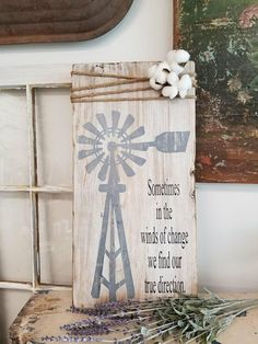 Sometimes in the winds of change we find our true direction Windmill sign with jute cord. COTTON NOT INCLUDED. This is painted using our barnwood whitewash technique with black fonts.