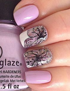 Beautiful and well detailed Purple nail art design. Painted in simple matte purple polish, the flowers are drawn in intricate styles on top using a thin black polish. It gives an ethereal effect to the nails.