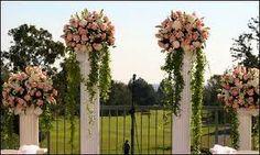 Flower arrangement on pillar column for wedding ceremony at Adelaide ...