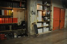 dPOP HQ - At its new home in the 129-year-old vault beneath downtown Detroit's Chrysler House – formerly the Dime Building – dPOP!'s designers have scavenged for items to repurpose alongside its new neon furniture and other bric-a-brac brought in from the outside (see photos).