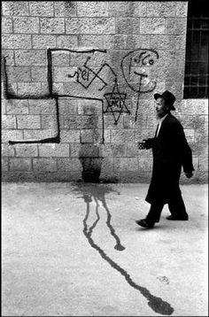 Photo by Leonard Freed - ISRAEL. 1972. Jerusalem. The star of David and swastikas sprayed on the walls of Jerusalem.