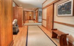 The hallway, itself a backdrop for art and sculpture, contains multiple coat closets, a powder room, and a wet bar neatly concealed behind a sliding door... | aspireNJ.com