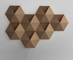 More cardboard, this time from NBT Studio. AmbiHive is a ambient wall light and a high-tech speaker in one.