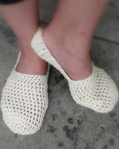 very simple and very cute!  I added a row of slip stitches and then two rows of half-double crochet to make them more of a bootie than a slipper, but as slippers they were adorable, too.  Very easy.  A beginner project, even!