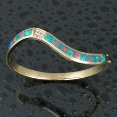Flowing Australian opal bracelet with pave` diamond accents in yellow gold by Mark Hileman. This opal bracelet is inlaid with genuine Australian opal. Australian Opal Jewelry, Bracelets, Bangles, Jade Jewelry, Opal Rings, Gold Rings, 14 Karat Gold, Jewelry Trends, Turquoise Bracelet
