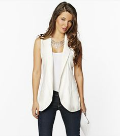 This is the sleeveless vest I've seen everywhere.  Be wary of this trend in white if you're a pear or bigger in the bust.  Totally Real World when applied well.