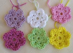 More small crochet flowers. These babies could be used in all sorts of ways from appliqueing on children's clothes to making a cherry blossom mobile or garland. Lovely.