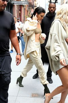 September 7, 2016 Midday, Jenner wears beige track pants, briefs, sports bra and parka with olive green sock boots all by Yeezy x Adidas on the way to the Yeezy Season 4 show.