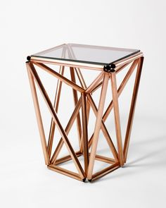 Ultraconductive This side table is made using Copper tubing from the local hardware store. The tubes are cut, polished, lashed together with nylon 'zip ties', and finished off with a glass top. Copper tube, nylon, glass