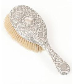 Victorian silver ladies hair brush Price £200.00 Victorian silver hairbrush with rococo foliate chased design, made in Birmingham in 1890. Very good condition.