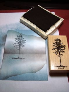 Create a reflected landscape, then stamp a tree