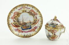 Early Dresden chocolate cup and cover on matching saucer with painted harbour scenes, marked A R, saucer 4.25'' diameter.